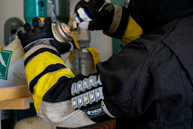 Chameleon chemical detection armband on a firefighter